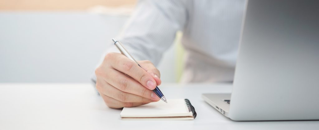 businessman hand writing content somethings notebook