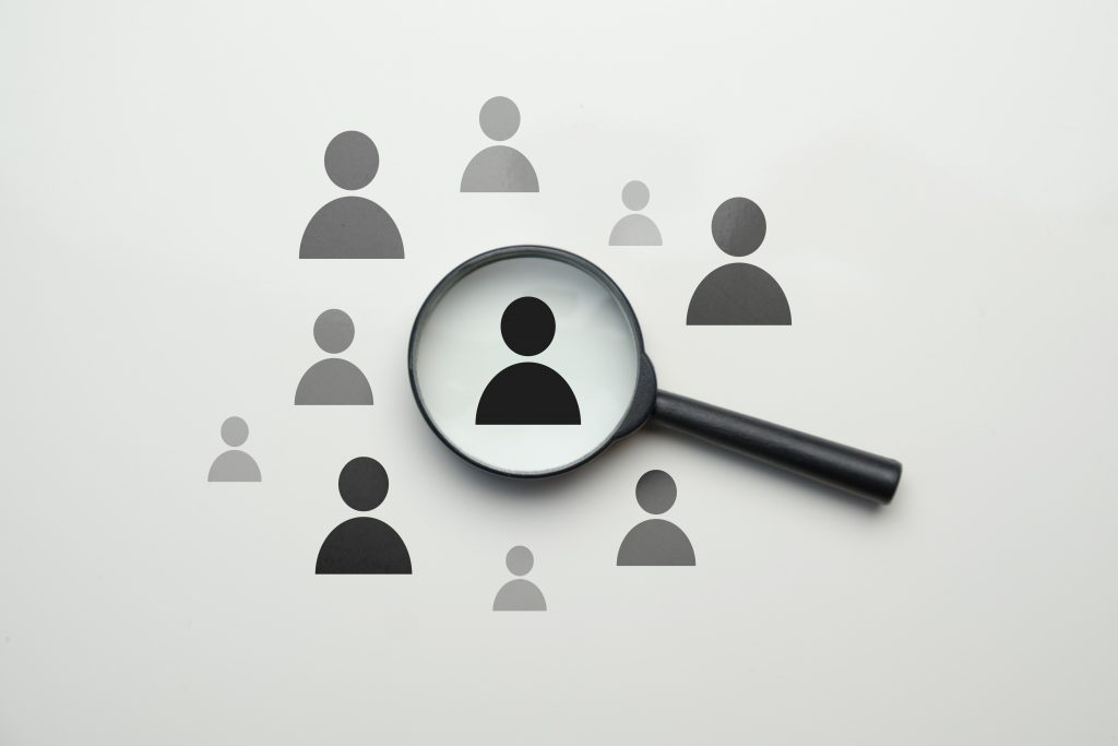 employee search hr concept magnifier with abstract employee white space